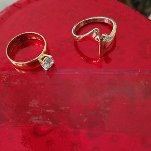 Two sz 7 gold plated cubic zirconium rings